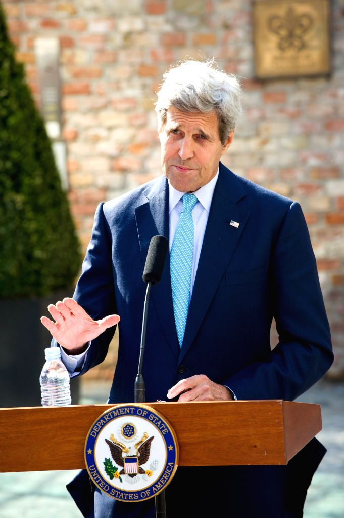 U.S. Secretary of State John Kerry delivers a statement in front of Palais Coburg where the Iranian nuclear talks take place in Vienna, Capital of Austria, July 5, ...