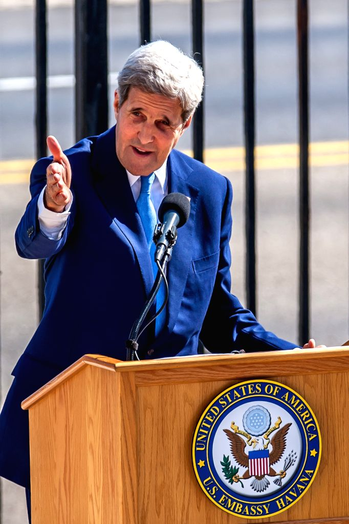 U.S. Secretary of State John Kerry gestures during the flag rising ceremony at the U.S. Embassy in Havana, Cuba, Aug. 14, 2015.