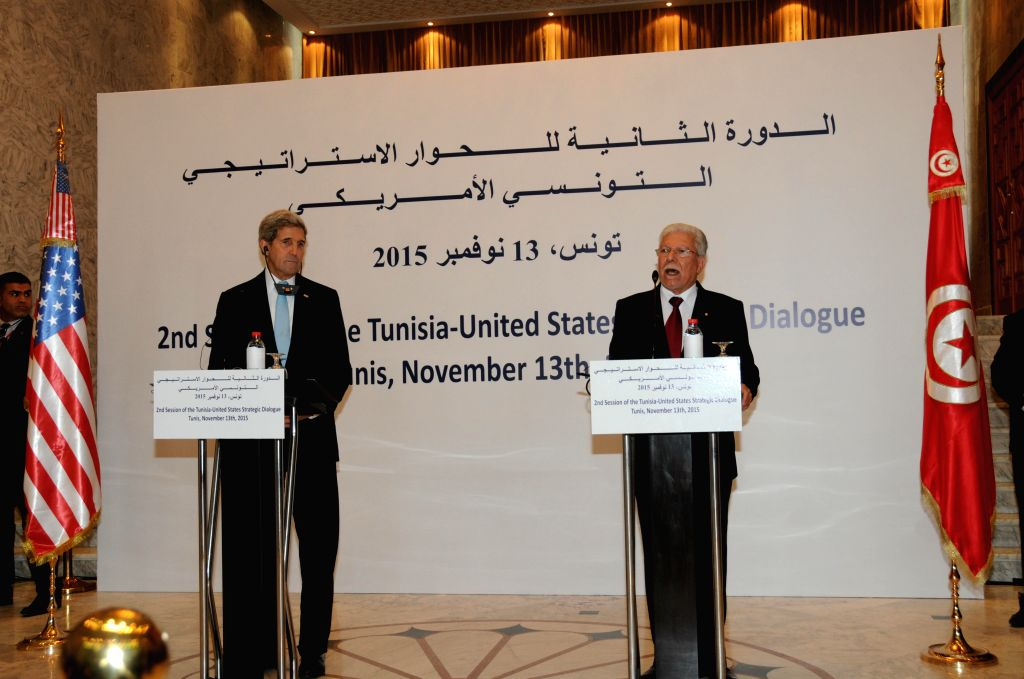 U.S. Secretary of State John Kerry (L) attends a press conference with Tunisian Foreign Minister Tayeb Baccouche in Tunis, Tunisia, Nov. 13, 2015. Kerry co-presided ... - Tayeb Baccouche