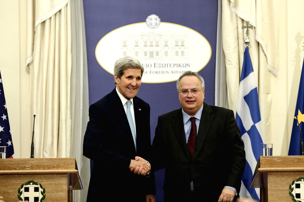 U.S. Secretary of State John Kerry (L) shakes hands with Greek Foreign Minister Nikos Kotzias during a news conference in Athens, capital of Greece, Dec. 4, ... - Nikos Kotzias