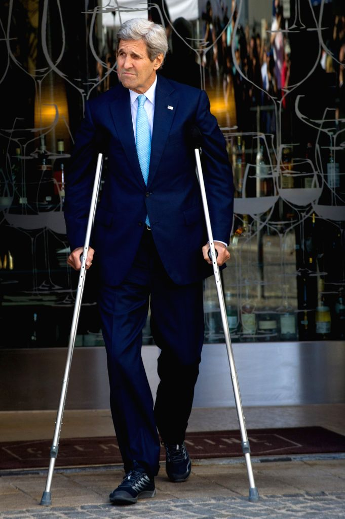 U.S. Secretary of State John Kerry walks using crutches to deliver a statement in front of Palais Coburg where the Iranian nuclear talks take place in Vienna, Capital ...