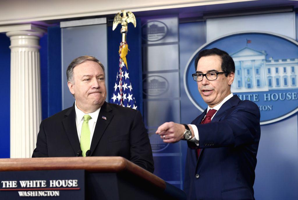 U.S. Secretary of the Treasury Steven Mnuchin (R) addresses a press briefing at the White House in Washington D.C., the United States, on Jan. 10, 2020. The U.S. ...