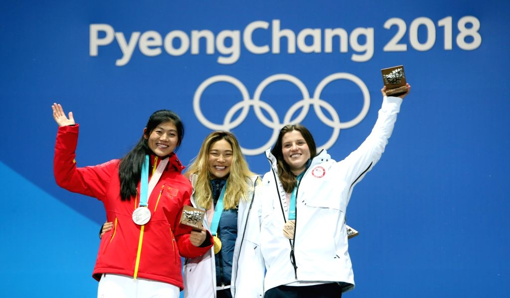 U.S. snowboard sensation Chloe Kim (C), Liu Jiayu of China (L) and Arielle Gold of the U.S. celebrate with gold, silver and bronze medals, respectively, during the medal ceremony of the ...