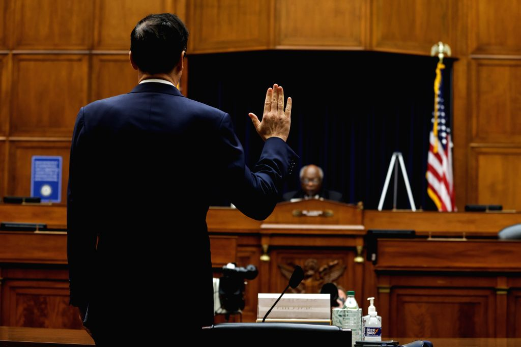 U.S. Treasury Secretary Steven Mnuchin (Front) is sworn in as he testifies before the U.S. House Select Subcommittee on the Coronavirus Crisis on the ...