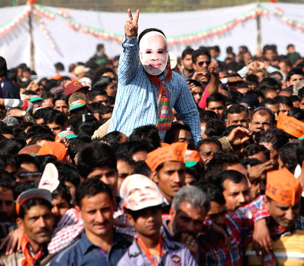 People gather at Prime Minister Narendra Modi's rally in Udhampur district of Jammu and Kashmir on Nov 28, 2014. - Narendra Modi