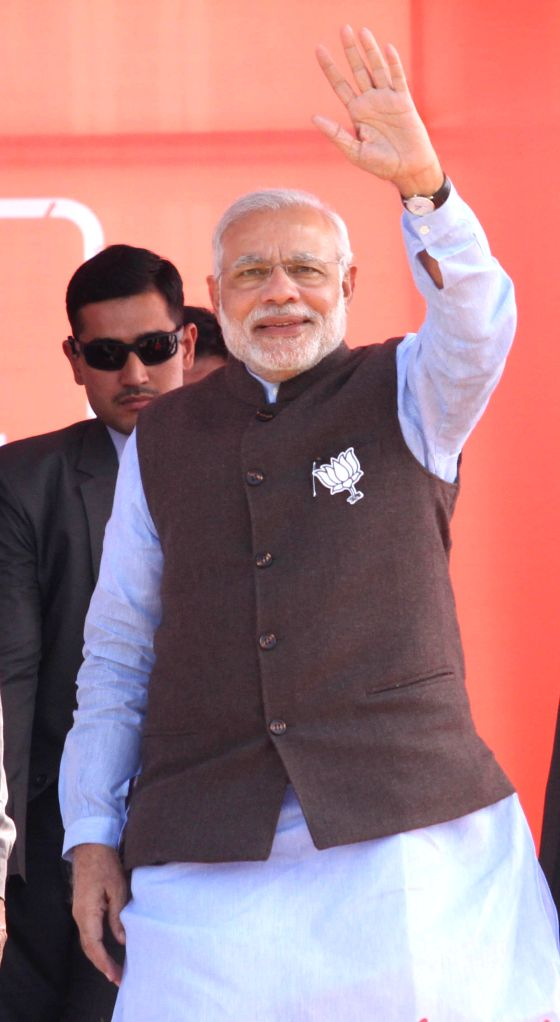 Prime Minister Narendra Modi waves to the public during a rally ahead of assembly elections in Udhampur district of Jammu and Kashmir on Nov 28, 2014. - Narendra Modi