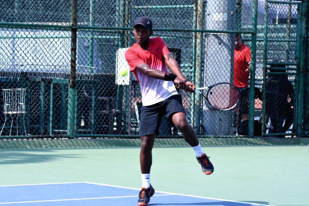 Udit Gogoi in action against Agriya Yadav in Boys U-16 category of the Fenesta Open Junior National Tennis Championship, in New Delhi on Oct 9, 2019. - Agriya Yadav