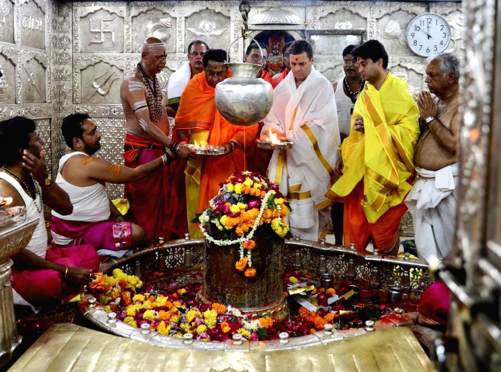 : Ujjain: Congress President Rahul Gandhi accompanied by party leaders Kamal Nath and Jyotiraditya Scindia, offers prayers at Mahakaleshwar Jyotirlinga temple in Madhya Pradesh's Ujjain on Oct ...