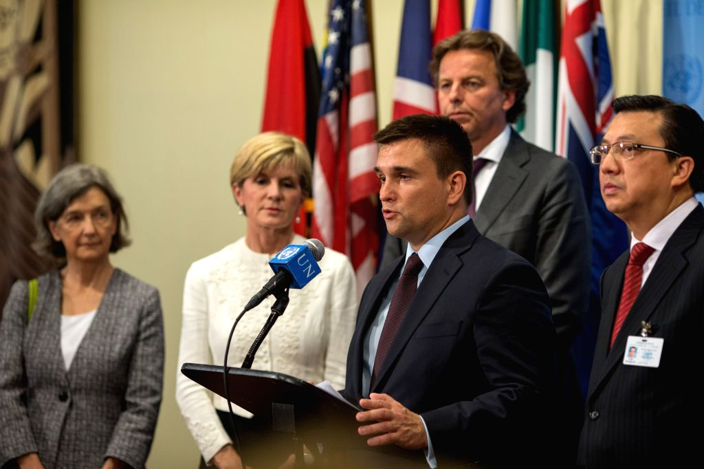 Ukrainian Foreign Minister Pavlo Klimkin(front), speaks to media at the United Nations headquarters in New York, July 29, 2015. Russia on Wednesday vetoed a draft ... - Pavlo Klimkin
