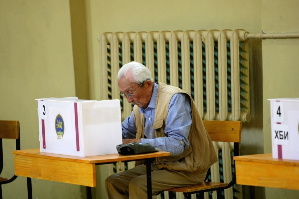 ULAN BATOR, June 26, 2017 - An old man writes his ballot at a polling station in Ulan Bator, Mongolia, June 26, 2017. Mongolians went to the polls Monday to elect a new president for the landlocked ...