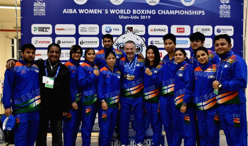 Ulan-Ude: India's MC Mary Kom, Manju Rani, Jamuna Boro and Lovlina Borgohain pose along with the coaching and support Staffs after the medal ceremony at AIBA Women's World Championships 2019 in ... - Mary Kom