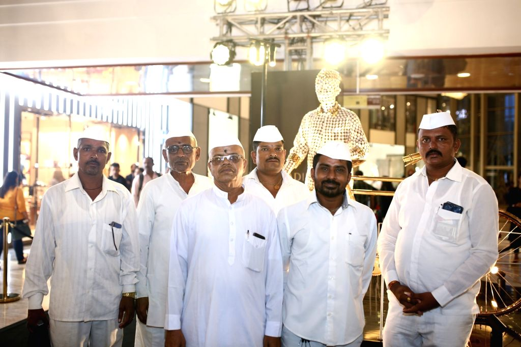 """Ullas Shantaram Muke with fellow dabbawalas during the launch of the comic book """"Dabbawala"""" penned and illustrated by artist Abhijeet Kini at a mega-function held at restaurant ... - Abhijeet Kini"""