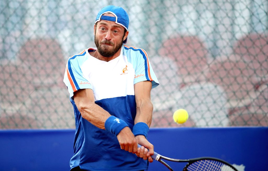 UMAG, July 18, 2019 - Paolo Lorenzi of Italy returns the shot to Laslo Djere of Serbia during the eighth finals at 2019 ATP Croatia Open in Umag, Croatia, on July 17, 2019.