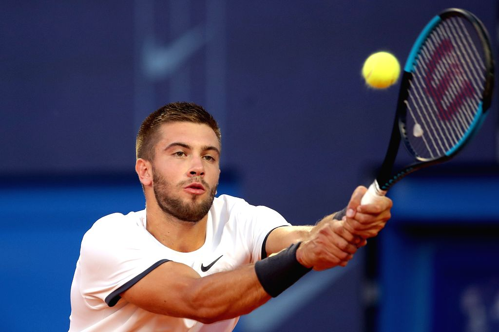 UMAG, July 19, 2019 - Borna Coric of Croatia returns the shot to  Salvatore Caruso of Italy during the eighth finals at 2019 ATP Croatia Open in Umag, Croatia, on July 18, 2019.