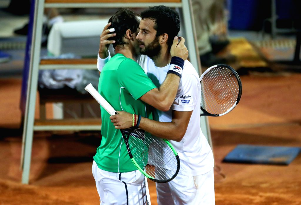 UMAG, July 21, 2019 - Dusan Lajovic (L) of Serbia greets Salvatore Caruso of Italy during the semi-finals at 2019 ATP Croatia Open in Umag, Croatia, on July 20, 2019. Caruso handed over the match due ...