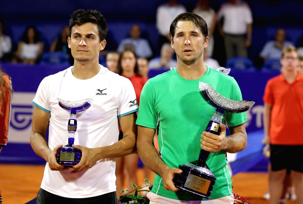 UMAG, July 22, 2019 - Dusan Lajovic of Serbia (R) and Attila Balazs of Hungary pose during the awarding ceremony after the final match at 2019 ATP Croatia Open in Umag, Croatia, on July 21, 2019.
