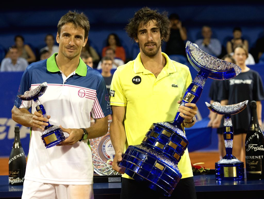 Pablo Cuevas of Uruguay (R) and Tommy Robredo of Spain pose with their trophies during awarding ceremony of the 25th Vegeta Croatia Open Umag ATP Tournament in Umag, ..