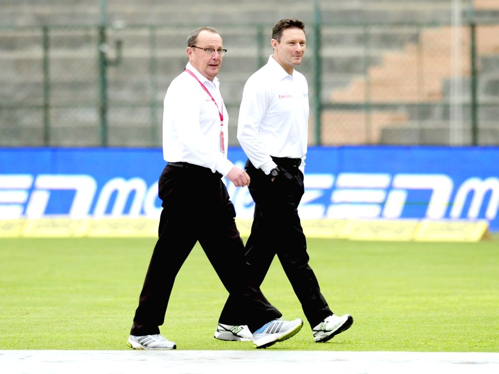 Umpires and match referees at M Chinnaswamy Stadium in Bengaluru, on Nov 18, 2015. The second test match between India and South Africa has been called off due to bad weather.