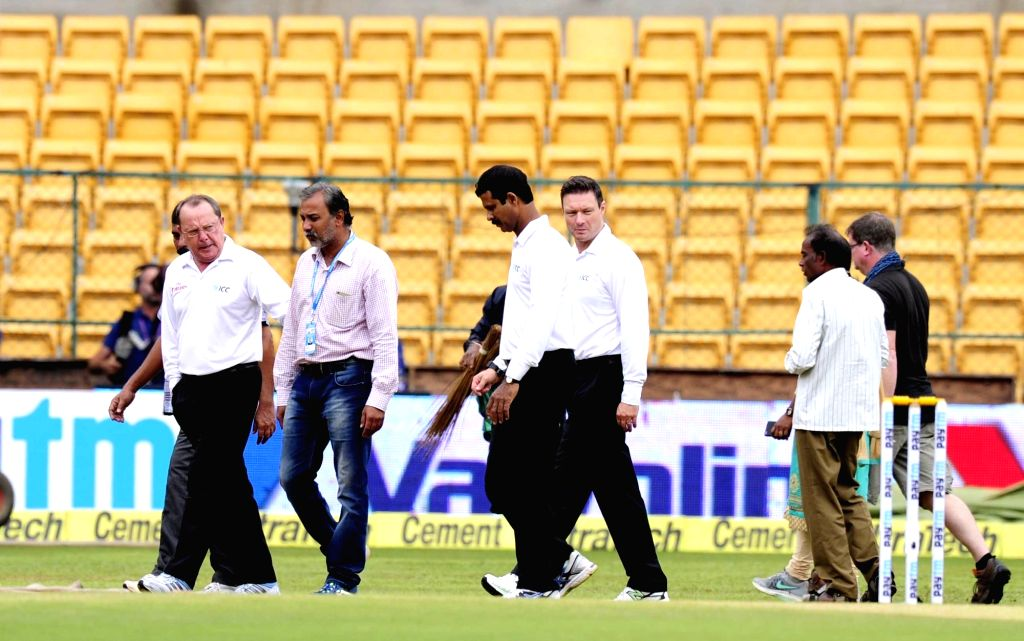 Umpires and match referees inspect the pitch on the 4th day of the second test match between India and South Africa at M Chinnaswamy Stadium in Bengaluru, on Nov 17, 2015.