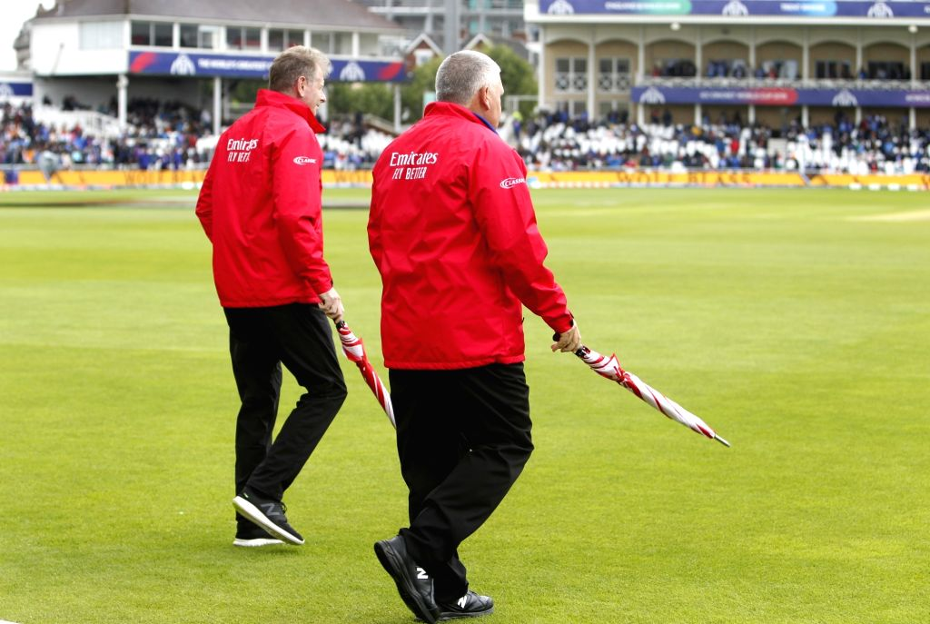 Umpires inspect the field at the Trent Bridge Cricket Ground after rains delayed the 18th Match of World Cup 2019 between India and New Zealand in Nottingham, England on June 13, 2019.