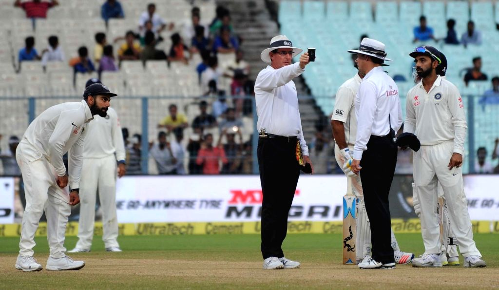 Umpires Richard Kettleborough and Rod Tucker check the light on Day 2 of the Second Test Match between India and New Zealand at Eden Gardens in Kolkata on Oct 1, 2016.
