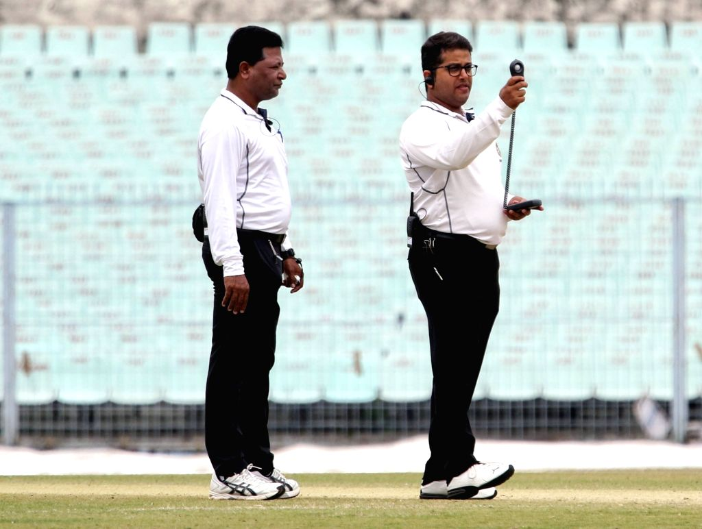 Umpires uses a light-o-meter to take note of the light during the Ranji Trophy match between Delhi and Bengal at the Eden Gardens in Kolkata on Jan 29, 2020.