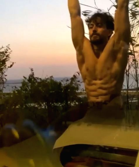 """Unable to hit the gym owing to the lockdown, Bollywood star Tiger Shroff has taken to playing football at home, besides of course keeping up with his workout regime. The """"Baaghi 3"""" actor shared a video on Instagram where he can be seen laying footbal"""
