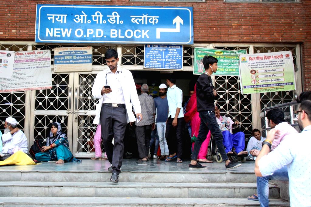 Unattended patients wait outside the OPD block of Loknayak Jayaprakash Narayan (LNJP) hospital where doctors went on a one day token strike and boycotted work to protest against the brutal ...
