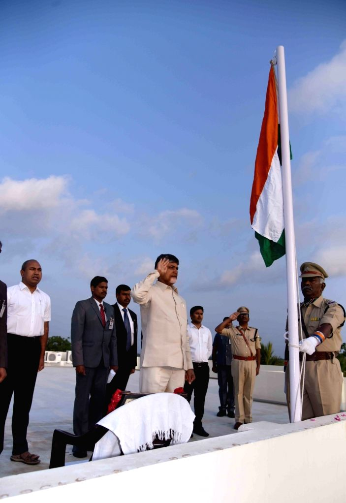 Undavalli: Andhra Pradesh Chief Minister N. Chandrababu Naidu salutes the national flag during 2019 Republic Day celebrations at Undavalli in Guntur district, on Jan 26, 2019. (Photo: IANS) - N. Chandrababu Naidu