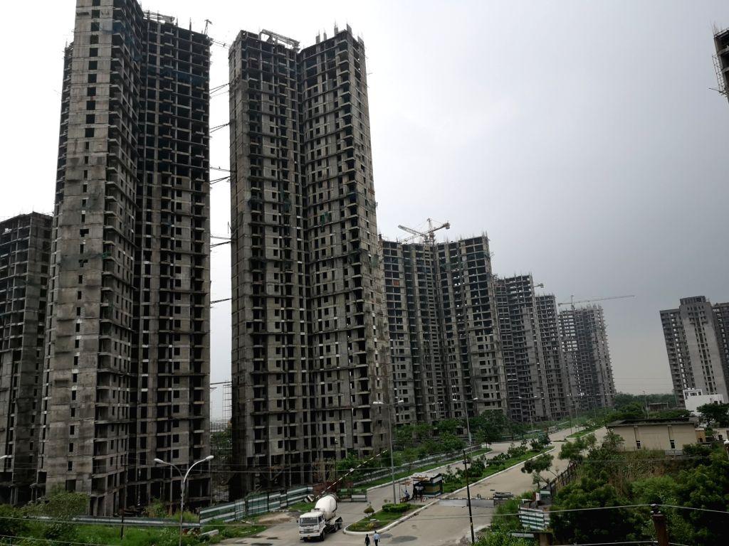 Under-construction buildings. (File Photo: IANS)