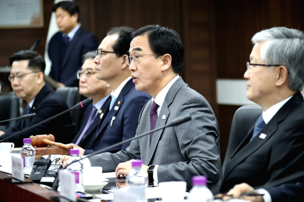 Unification Minister Cho Myoung-gyon (2nd from R) chairs a meeting on inter-Korean exchanges and cooperation at the government complex in Seoul on Feb. 14, 2018, amid a recent thaw in ... - Cho Myoung