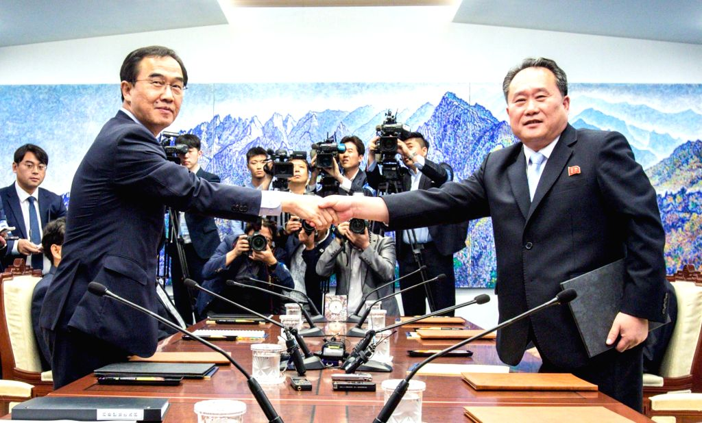Unification Minister Cho Myoung-gyon (L) shakes hands with Ri Son-gwon, chairman of North Korea's Committee for the Peaceful Reunification of the Country, after signing a joint press ... - Cho Myoung