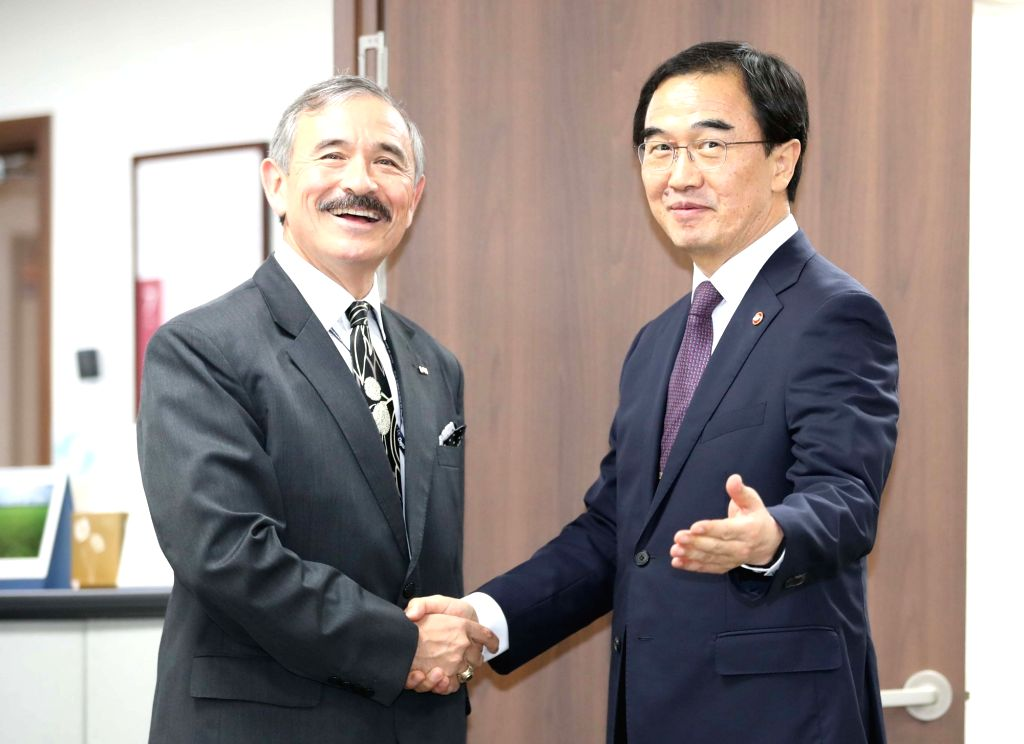 Unification Minister Cho Myoung-gyon (R) meets new U.S. Ambassador to Seoul Harry Harris at his ministry in Seoul on July 23, 2018. Harris, former head of the U.S. Pacific Command, assumed his ... - Cho Myoung