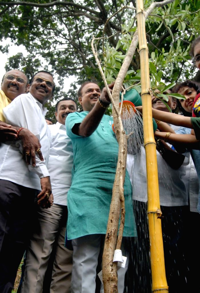 Union Chemicals and Fertilizers Minister Ananth Kumar plants a sapling on World Environment Day in Bengaluru, on June 5, 2016. - Ananth Kumar