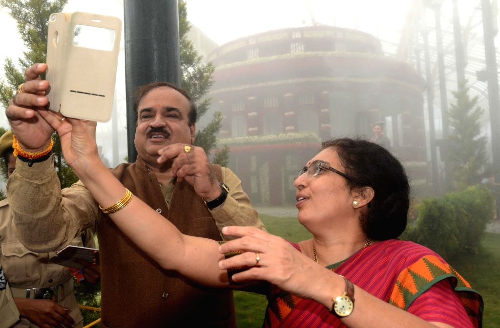 Union Chemicals and Fertilizers Minister Ananth Kumar and his wife Tejaswini take a selfie -self portrait- at Independence Day Flower Show organised at Lalbagh in Bengaluru, on Aug 14, ... - Ananth Kumar
