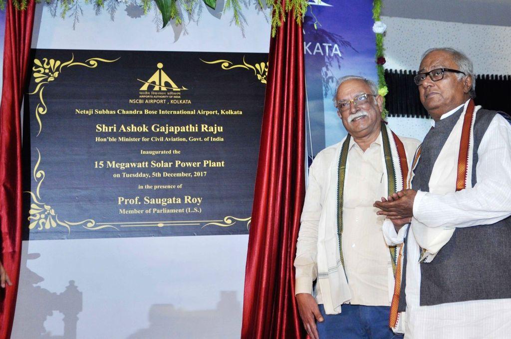 Union Civil Aviation Minister P. Ashok Gajapathi Raju addresses during inauguration ceremony of 15 MW solar power plant at Netaji Subhas Chandra Bose International Airport in Kolkata, on Dec ... - P. Ashok Gajapathi Raju