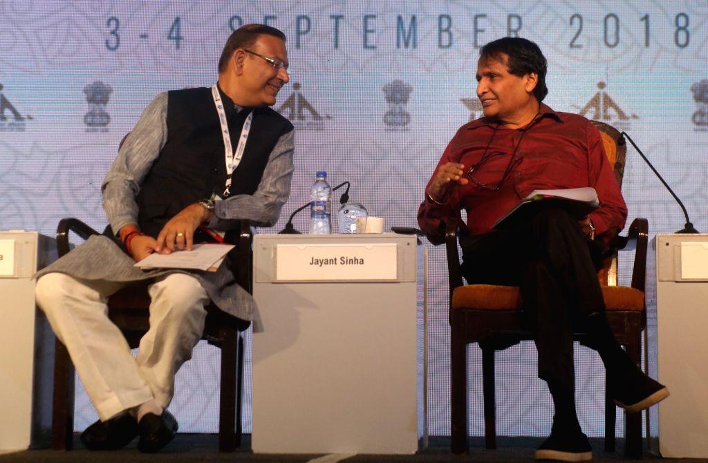 Union Civil Aviation Minister Suresh Prabhu in a conversation with Union MoS Civil Aviation Jayant Sinha during International Aviation Summit, in New Delhi on Sept 4, 2018. - Suresh Prabhu and Aviation Jayant Sinha