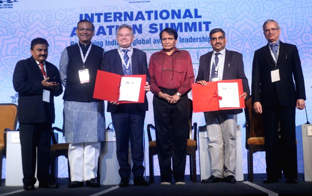 Union Civil Aviation Minister Suresh Prabhu, Union MoS Civil Aviation Jayant Sinha and other dignitaries during International Aviation Summit, in New Delhi on Sept 4, 2018. - Suresh Prabhu and Aviation Jayant Sinha