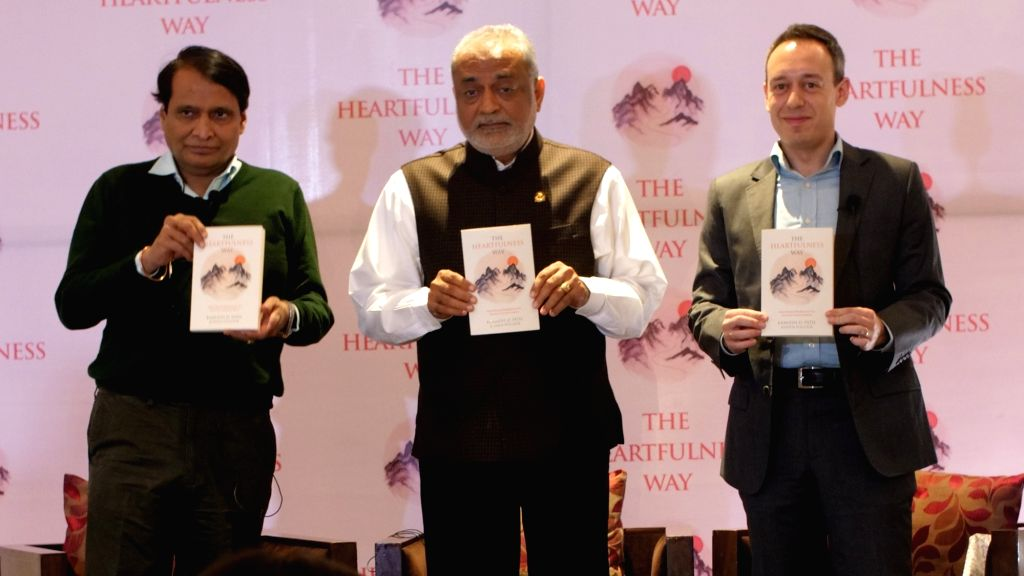 Union Commerce and Industries Minister Suresh Prabhu launches Kamlesh Patel's book 'The Heartfulness Way' in New Felhi. - Suresh Prabhu and Kamlesh Patel