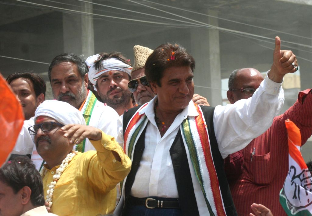 Union Commerce and Industry Minister Anand Sharma and actor-turned-politician Raj Babbar accompany Congress candidate for 2014 Lok Sabha Election from Varaansi, Ajay Rai as he proceeds to file his ... - Anand Sharma
