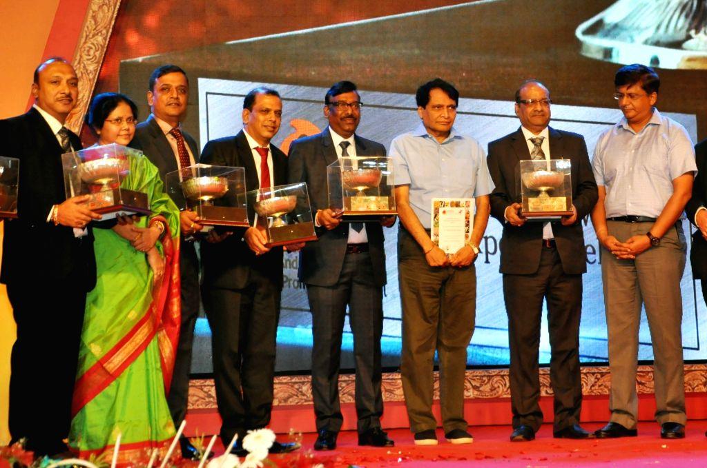 Union Commerce and Industry Minister Suresh Prabhakar Prabhu SHEFEXIL Awards For Export Excellence to the awardees at an award presentation programme, in Kolkata on July 7, 2018. - Suresh Prabhakar Prabhu S