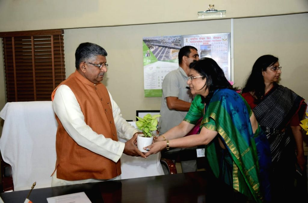 Union Communication Minister Ravi Shankar Prasad being greeted by the ministry's officials after taking charge of office, at Sanchar Bhawan in New Delhi on June 3, 2019. - Ravi Shankar Prasad