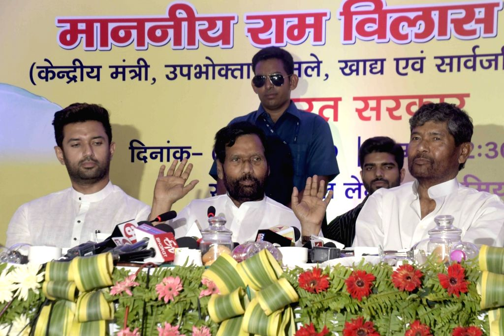 Union Consumer Affairs, Food and Public Distribution Minister Ram Vilas Paswan accompanied by his son Chirag Paswan, addresses a press conference, in Patna, on June 2, 2019. - Ram Vilas Paswan