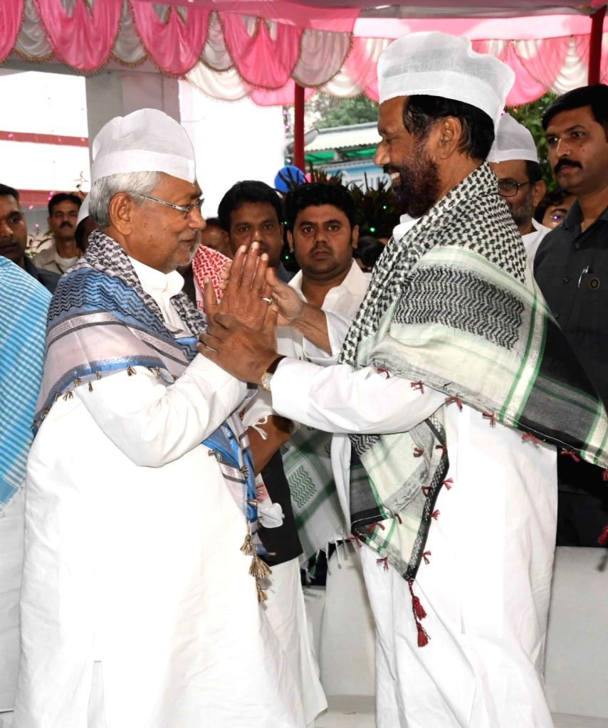 Union Consumer Affairs, Food and Public Distribution Minister Ram Vilas Paswan with Bihar Chief Minister Nitish Kumar during an iftar party in Patna, on June 3, 2019. - Ram Vilas Paswan and Nitish Kumar