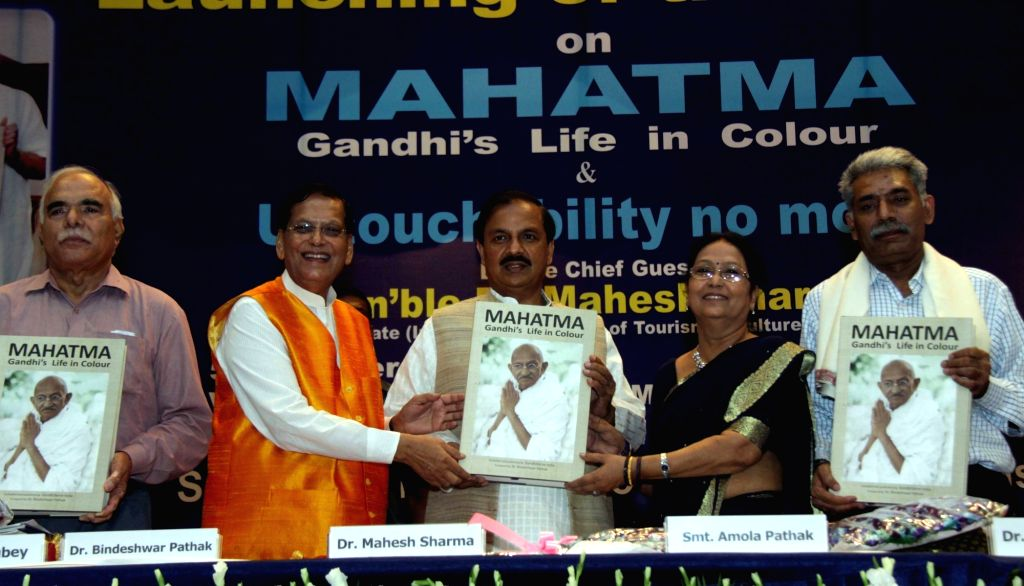 """Union Culture and Tourism Minister Mahesh Sharma at the launch of """"MAHATMA - Gandhi's Life in colour"""" first colourised photo biography on Mahatma Gandhi in New Delhi, on Oct 5, ... - Mahesh Sharma"""