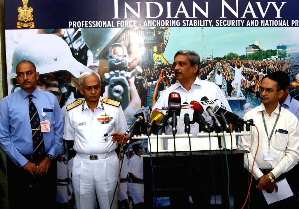 Union Defence Minister Manohar Parrikar addresses a press conference during the Naval Commanders' Conference, in New Delhi on Oct 25, 2016. Also seen Chief of Naval Staff, Admiral Sunil ... - Manohar Parrikar