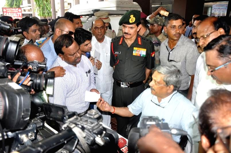 Union Defence Minister Manohar Parrikar talks to press after visiting  soldiers injured in the fire that broke out at Indian Army's ammunition depot in Maharashtra's Pulgaon, in Wardha, on ... - Manohar Parrikar