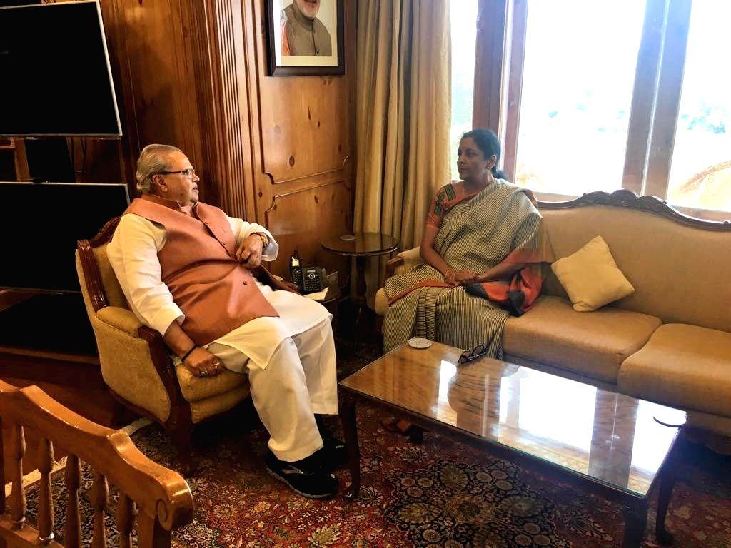 Union Defence Minister Nirmala Sitharaman calls on Jammu and Kashmir Governor Satya Pal Malik, in Srinagar, on Sept 2, 2018. - Nirmala Sitharaman and Malik