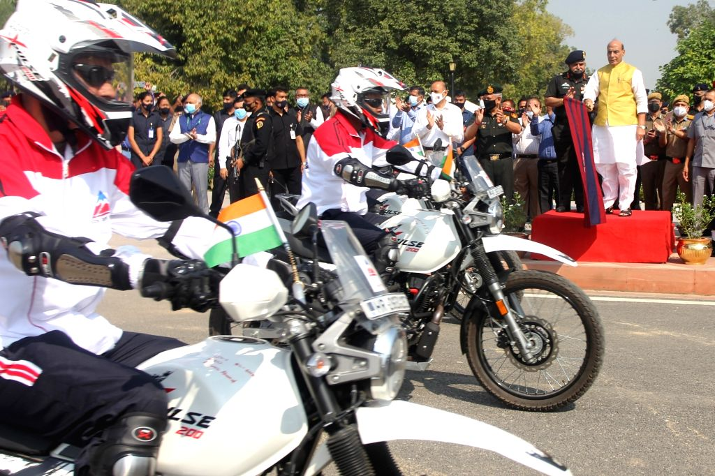 Union Defence Minister Rajnath Singh Flags off Border Road Organization(BRO) motorcycle expedition in New Delhi on Thursday October 14,2021, . - Rajnath Singh Flags