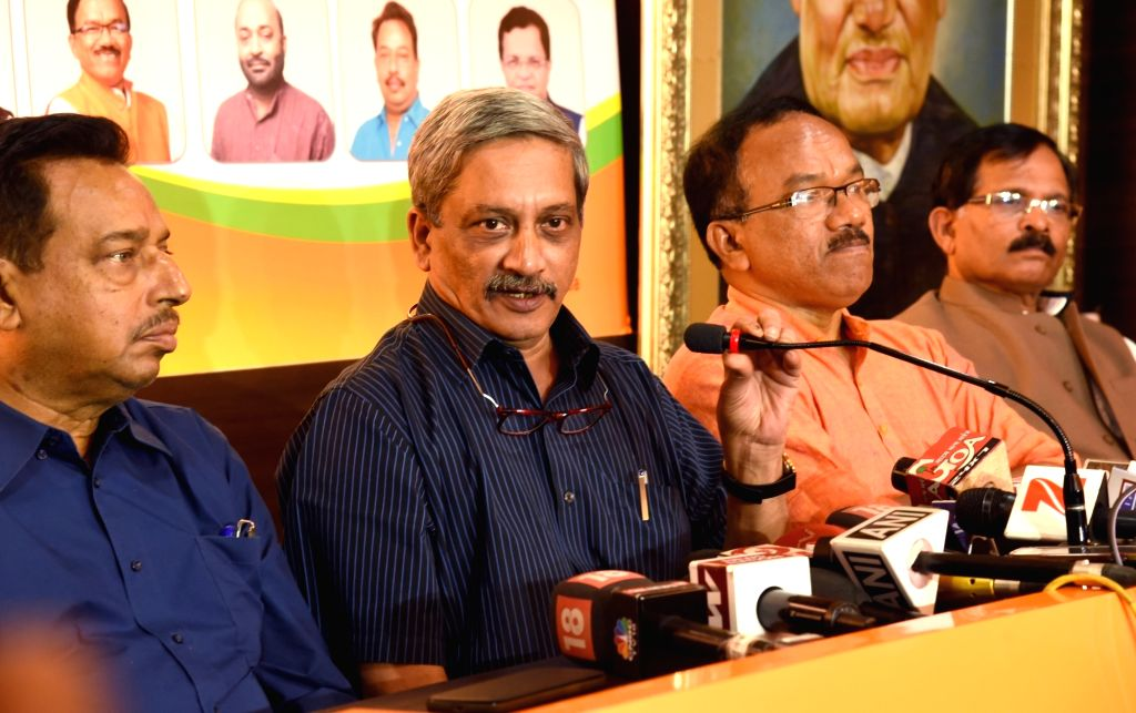 Union Defense Minister Manohar Parrikar addresses a press conference after results of Goa Assembly Elections declared in Panaji on March 11, 2017. Also seen Goa Chief Minister Laxmikant ... - Manohar Parrikar